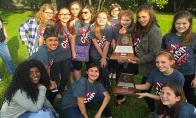 image Flour Bluff Junior High choir students show off their plaque from the UIL Middle School Concert and Sight Reading Contest
